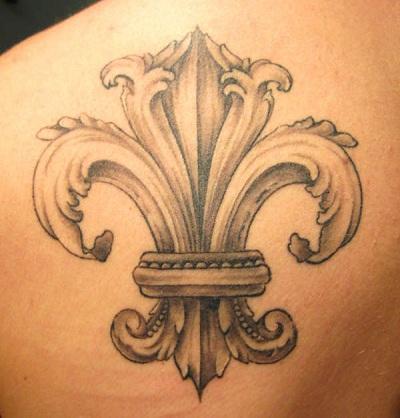Fleur de lis tattoo on lower back